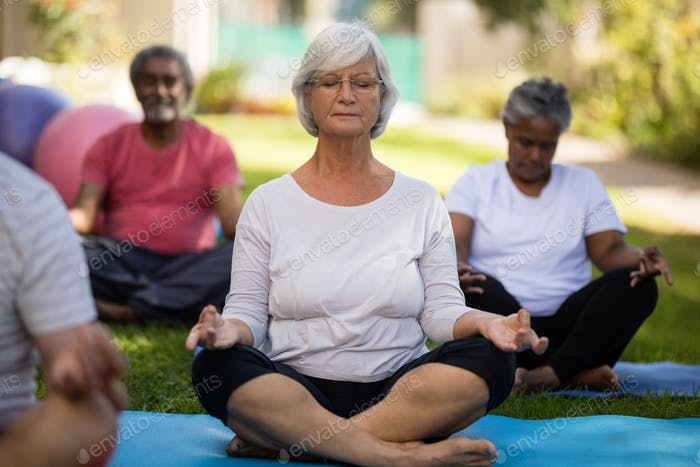 Senior woman meditating with closed eyes