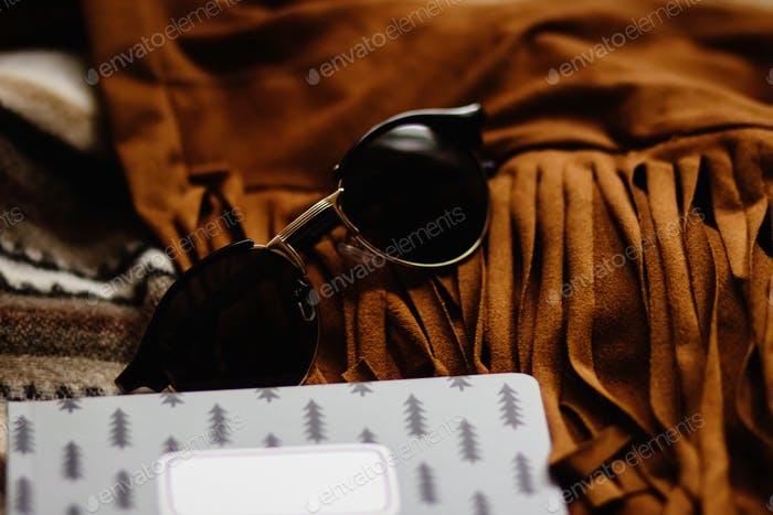 boho gypsy stylish elements of jacket fringe sunglasses notebook and camera