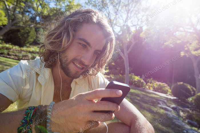Happy man listening to music on mobile phone
