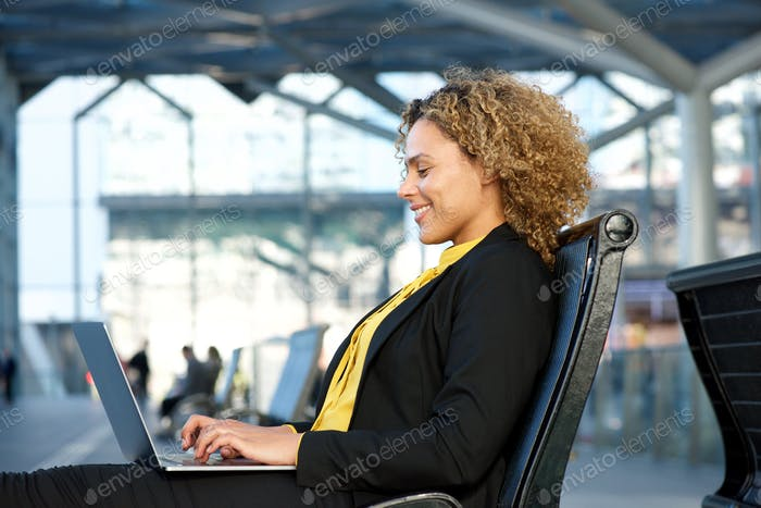 african american business woman working on laptop
