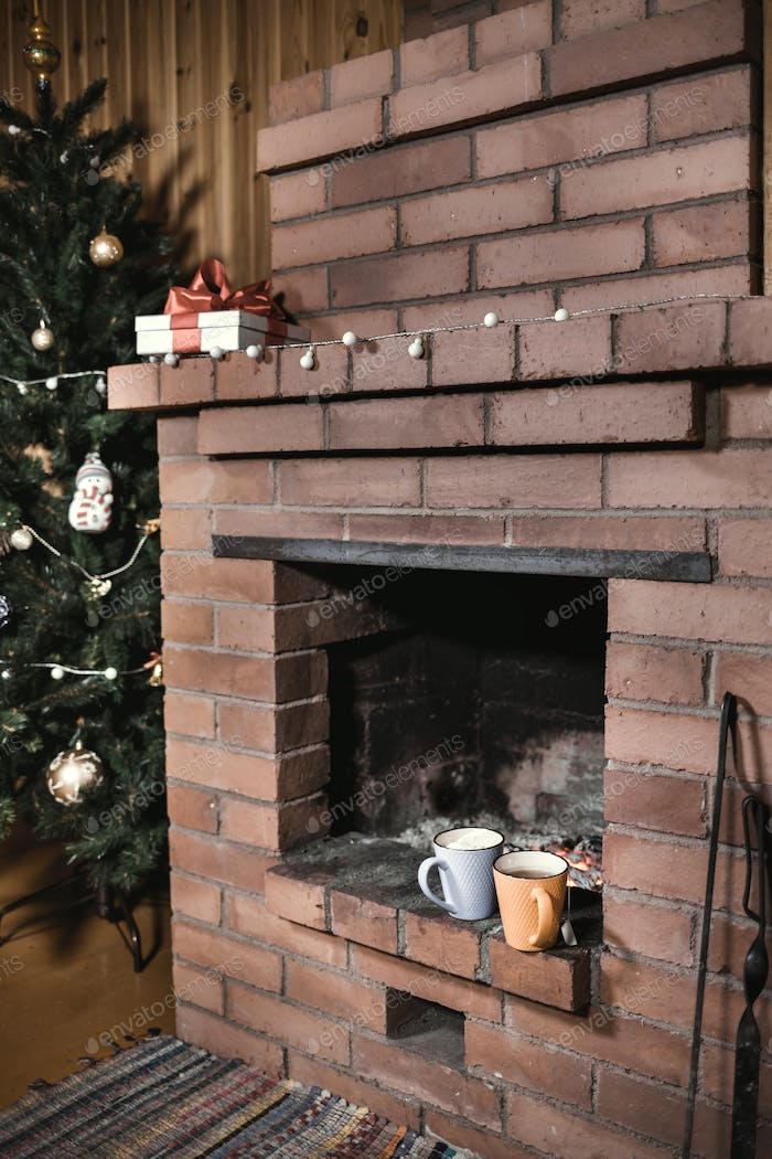 Christmas tree near fireplace