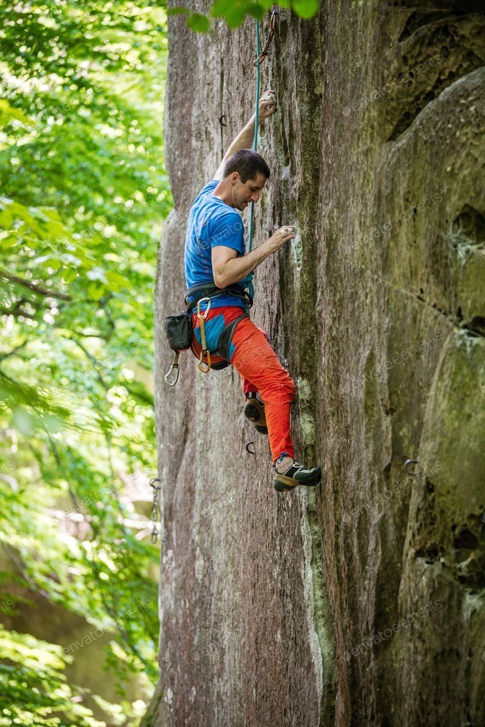 Rock climber on challenging route