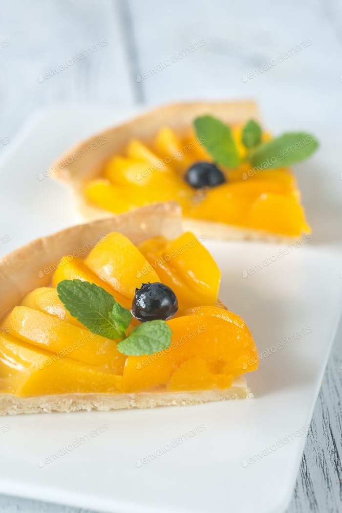 Slices of tart with peaches and blueberry