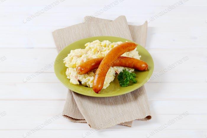thin sausages with potato salad