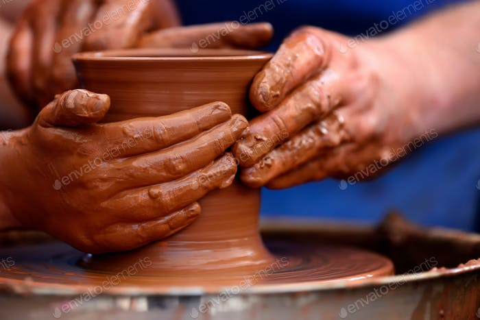 Potter making ceramic pot on the pottery wheel