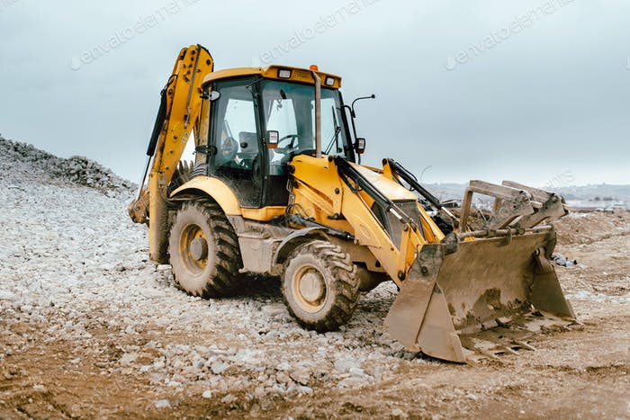 Industrial backhoe excavator loader and bulldozer machinery on construction site