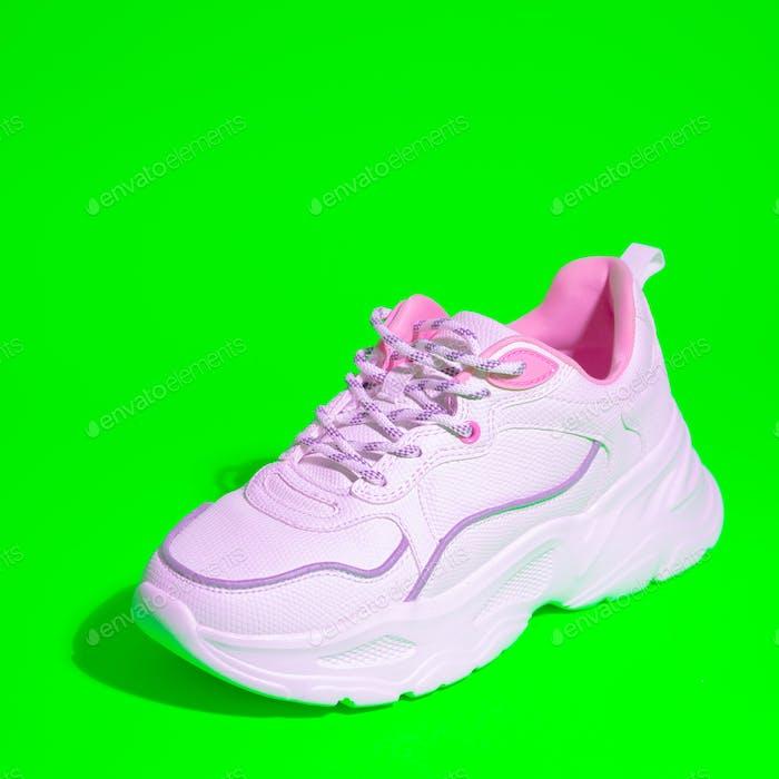 Trendy sport shoes. White sneakers. Minimal fashion design