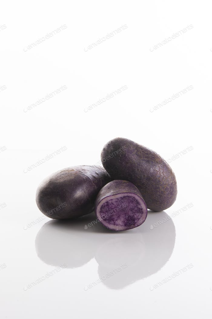 Purple potatoes with white background, Vitelotte noire