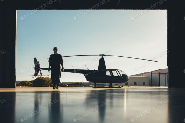 Pilot walking away from helicopter