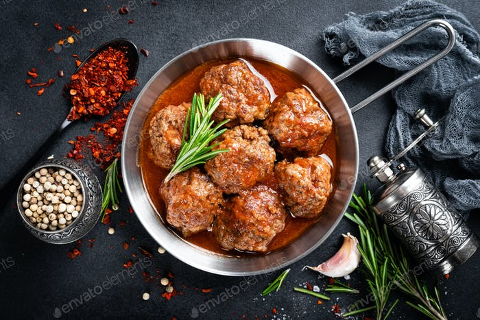 Beef meatballs with spices in tomato sauce