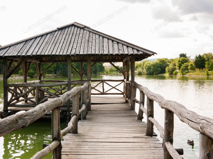 Wooden shelter on a quiet lake
