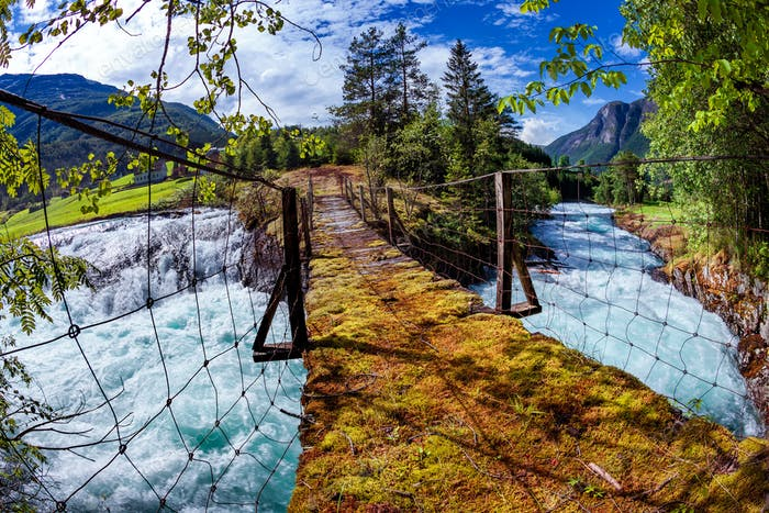 Suspension bridge over the mountain river, Norway.