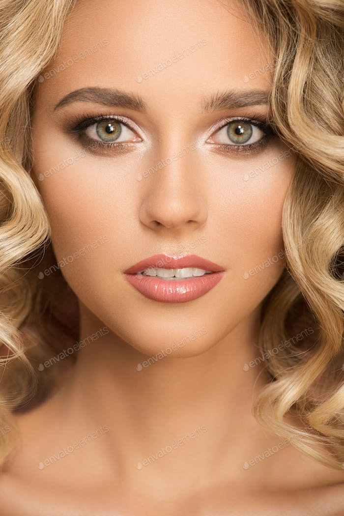 Blonde Woman With Curly Beautiful Hair. Close Up Portrait.