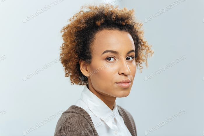 Beautiful african american businesswoman with curly hair