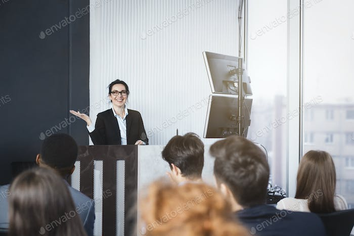 Business woman giving presentation at conference room