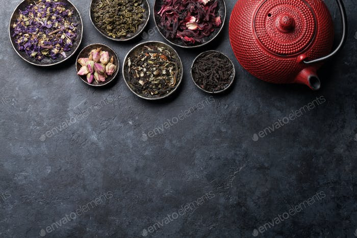 Various dry tea and teapot