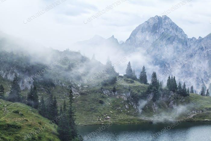 morning fog over alpine peaks