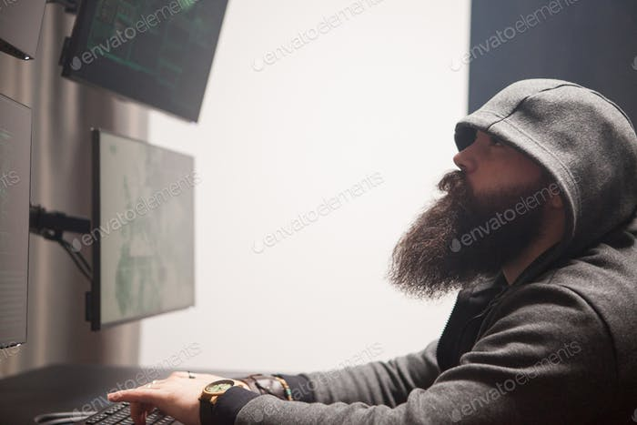 Focused bearded hacker to destroy the system