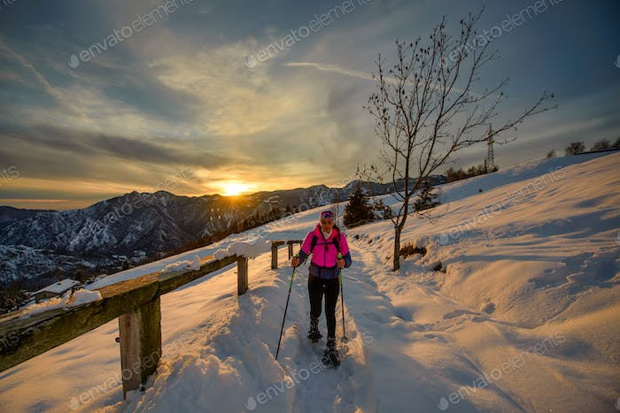Young woman alone on snowshoe hike