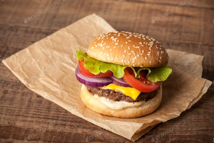 Fresh burger on wooden table