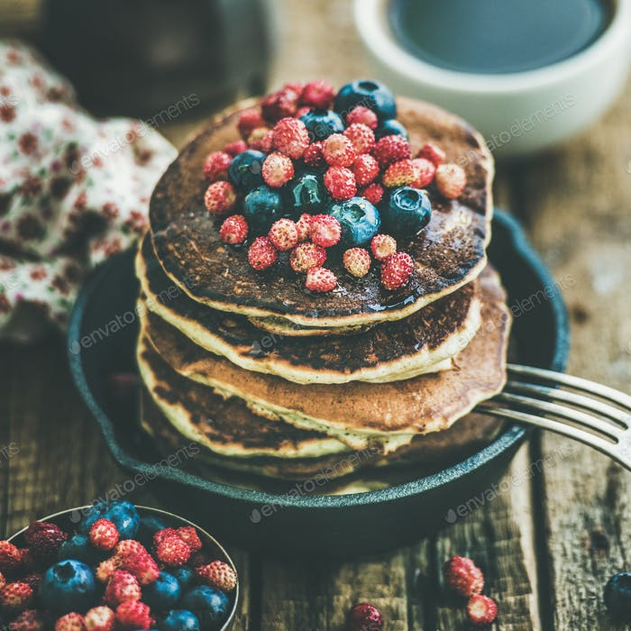 Breakfast with pancakes with forest berries and honey, square crop