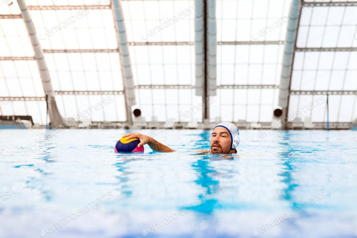 Water polo player in a swimming pool.