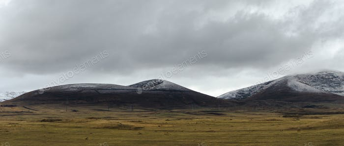 Valley, clouds and sky above the mountains in Armenia wide screen