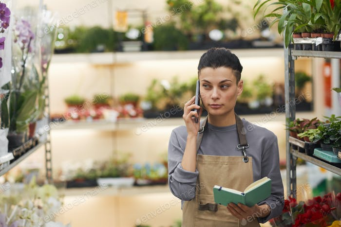Contemporary Businesswoman in Flower Shop