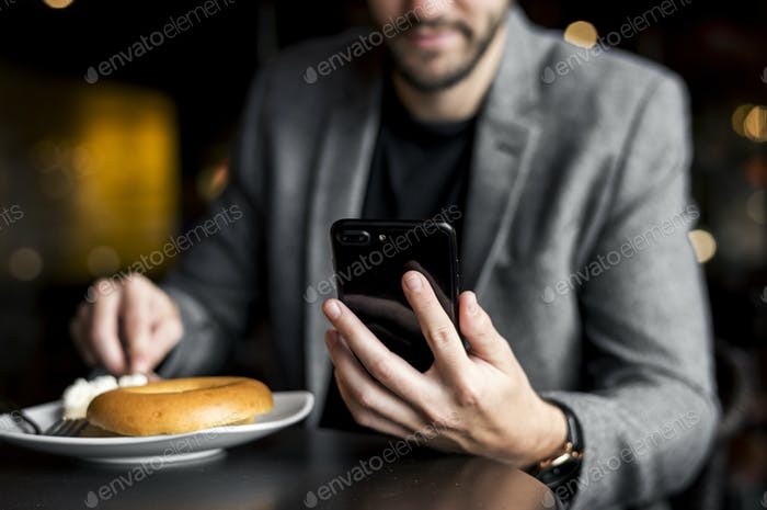 Man reading messages on his phone