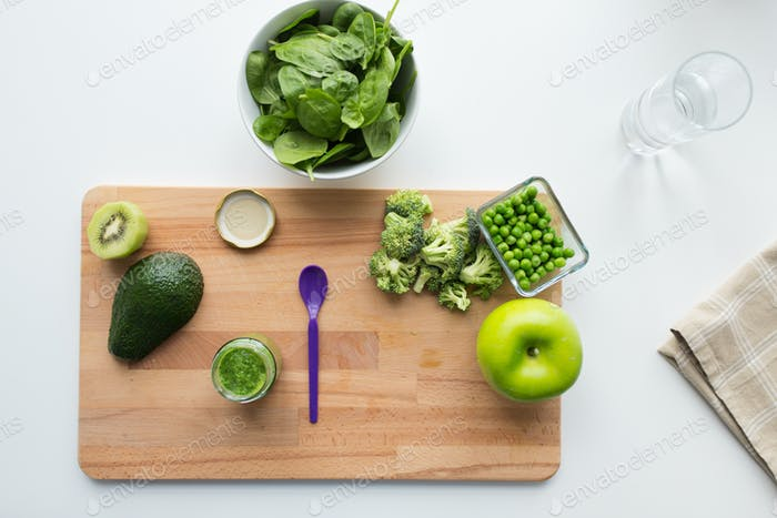 vegetable puree or baby food and fruits on board