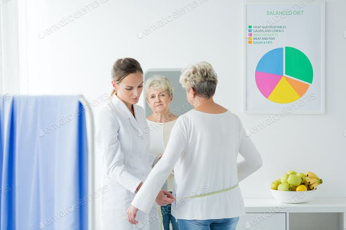 Dietician measuring patient's body circuit