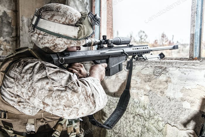 Army sniper shooting with large caliber rifle
