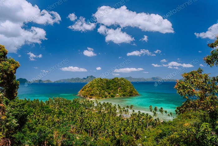 Tropical scenery of bacuit archipelago with palm trees, island and blue lagoon. El Nido, Palawan