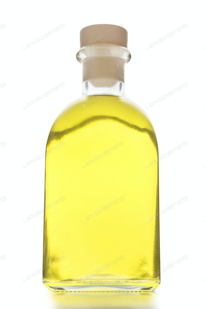 Organic oil in glass bottle on white