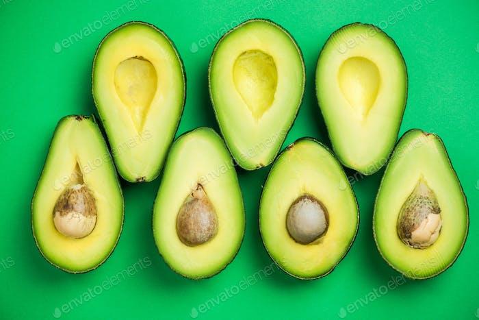 Avocado flat lay on green pastel background