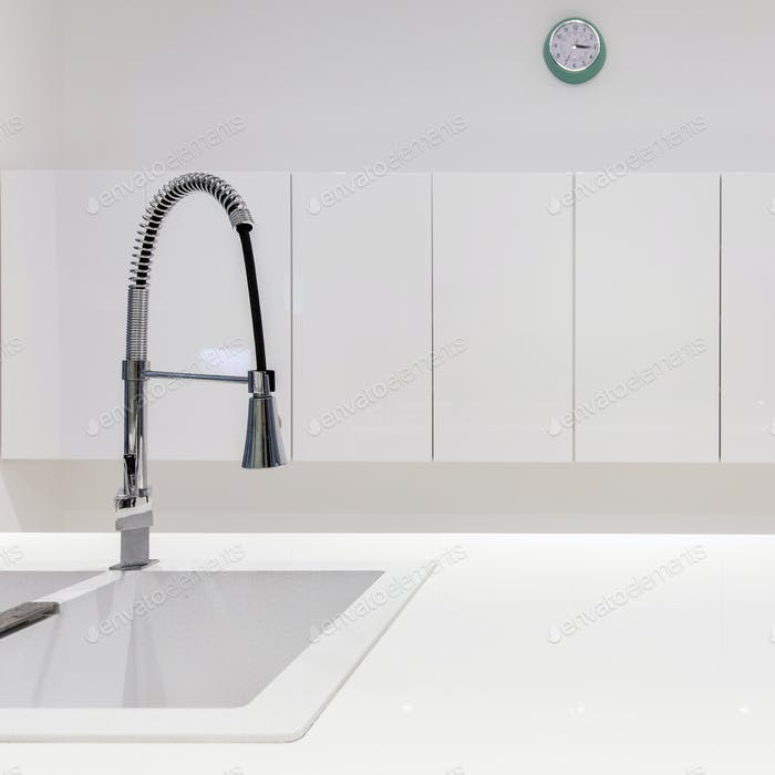 Steel sink in modern kitchen
