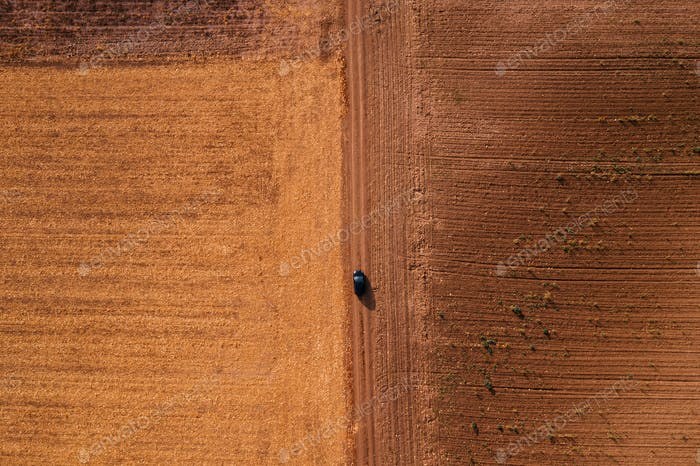 Driving car on dirt road, aerial view