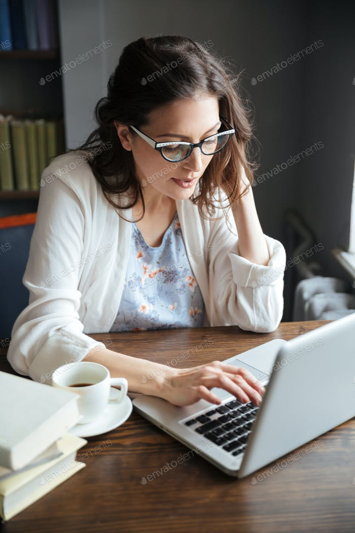 Portrait of a serious attractive mature business woman working