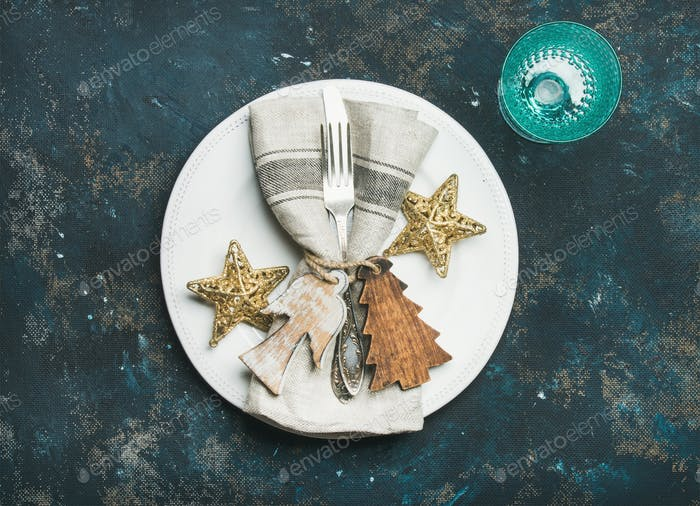 Christmas, New Year holiday table setting over dark blue background
