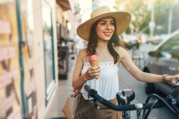 Beautiful woman eating ice cream