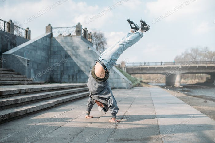 Breakdance performer, upside down motion on street