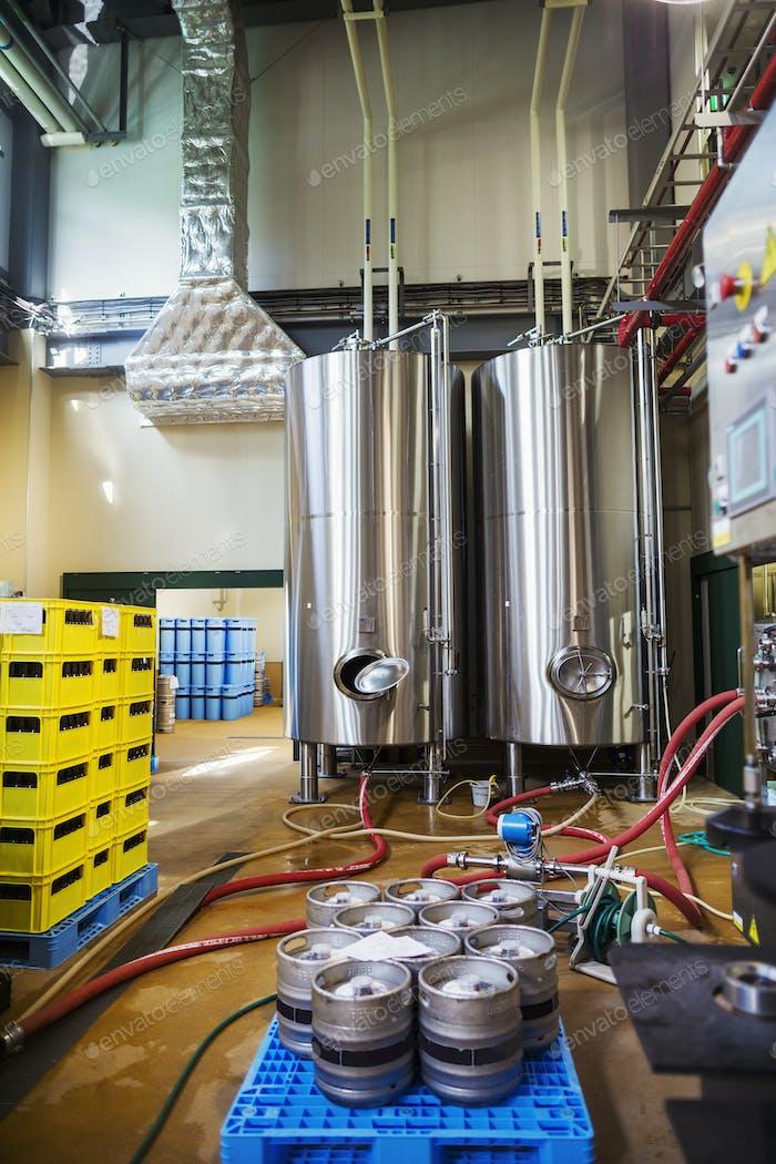 Metal beer tanks in a brewery.