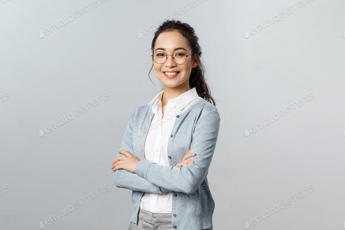 Education, women and lifestyle concept. Attractive asian female entrepreneur, girl tutor smiling
