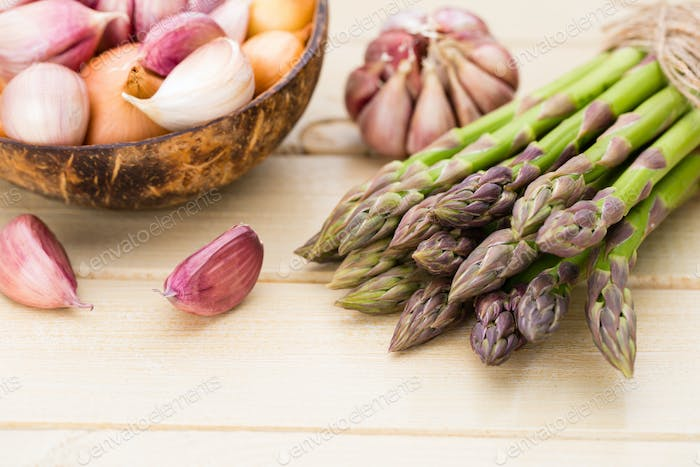 Bunch of fresh asparagus on wooden table.