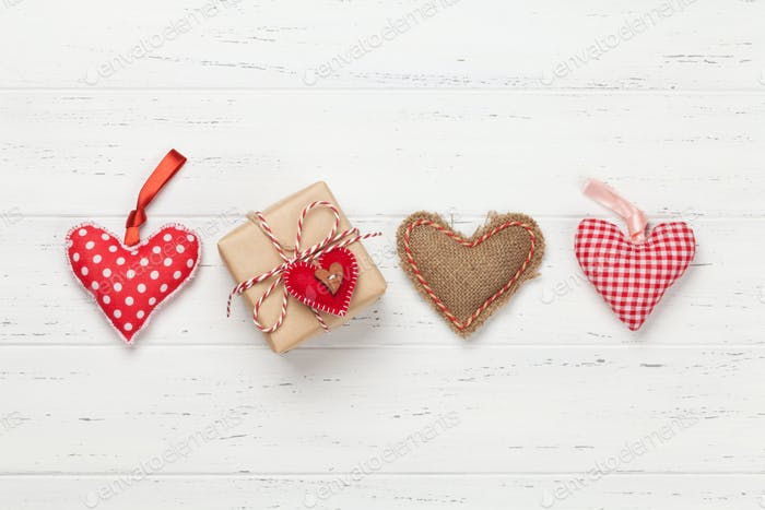 Valentines day card with hearts and gift box