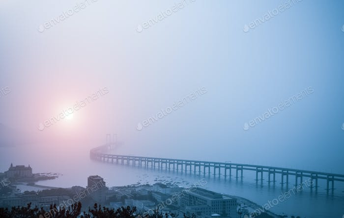 bay bridge in the morning fog