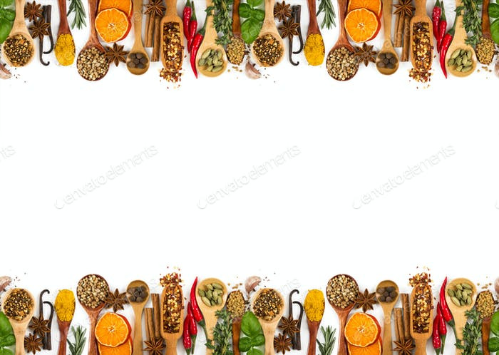 Different spices, seasonings and herbs isolated on white