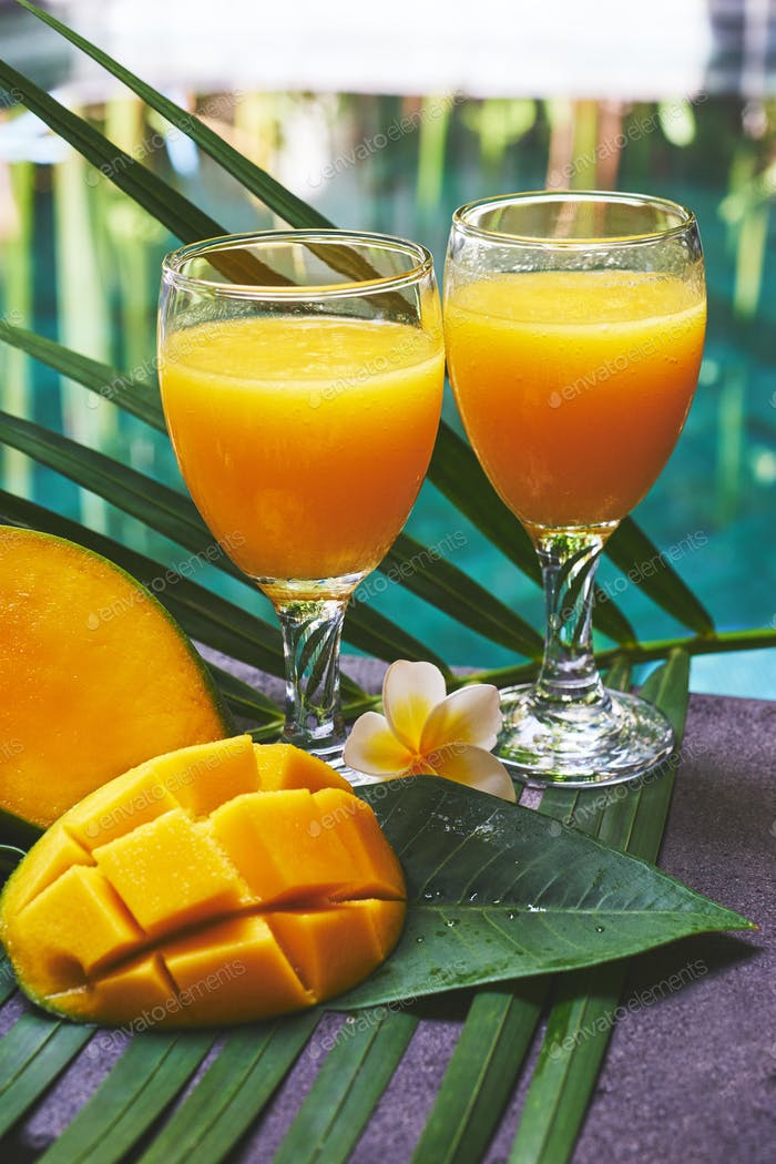 Glasses of fresh tropical smoothie or mango juice