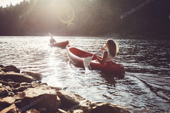 kayakers rowing on a lake