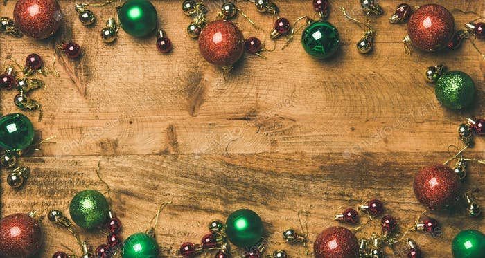 Christmas tree decoration balls on wooden background, top view